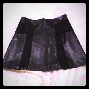 Black leather and lace mini skirt